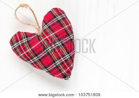 Decorative Fabric Heart  On Wood Background