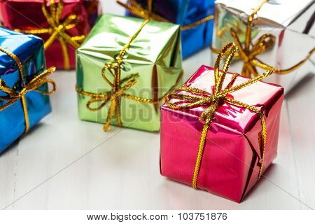 Small Gift Boxes On White Wood Background