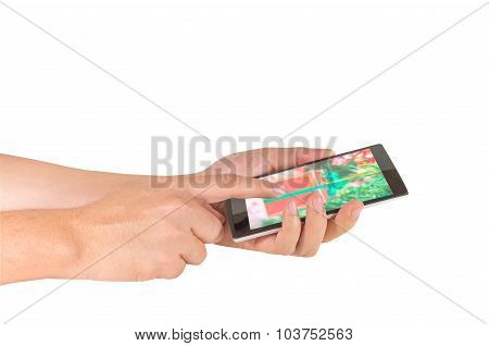 Image Of Male Hand Is Holding A Modern Touch Screen Smart Phone And Using It .