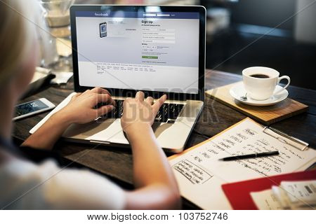 BANGKOK, THAILAND-October 2,2015: Young Woman Using Facebook Application on her Laptop
