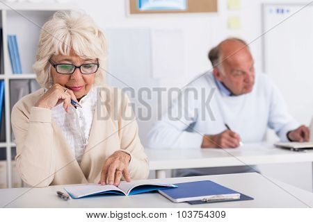 Elderly Students Working In Class