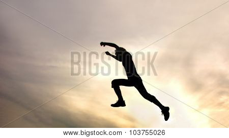 silhouette of jumping boy against sky. Header for website