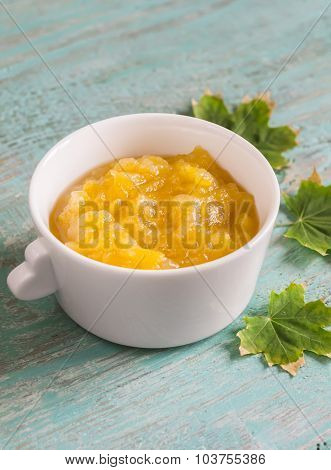 Apple Sauce In A White Bowl On Blue Wooden Surface