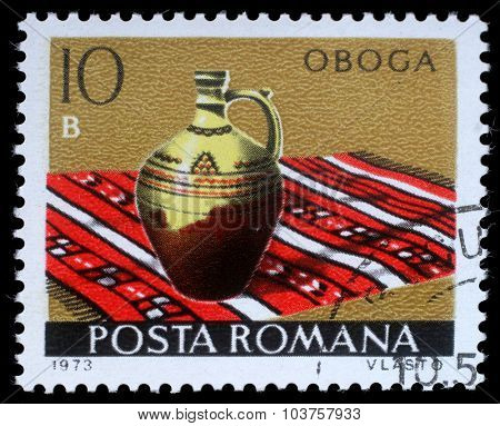 ROMANIA - CIRCA 1973: a stamp printed in Romania shows Oboga from the series Romanian pottery, circa 1973.