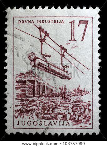 YUGOSLAVIA - CIRCA 1958: A stamp printed in Yugoslavia shows lumber industry, circa 1958