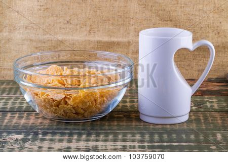 Corn flakes and cup with milk