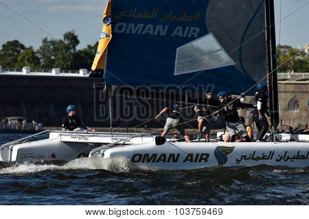 ST. PETERSBURG, RUSSIA - AUGUST 20, 2015: Catamaran of Oman Air sailing team during 1st day of St. Petersburg stage of Extreme Sailing Series. Red Bull Sailing Team of Austria won the day