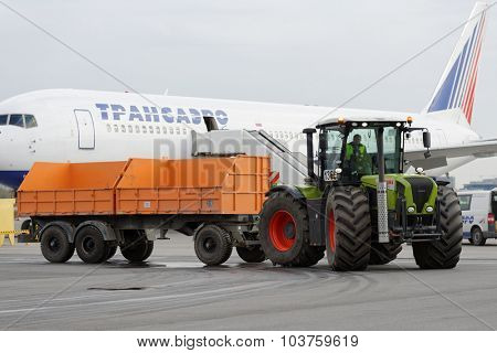 ST. PETERSBURG, RUSSIA - SEPTEMBER 24, 2015: Tractor Xerion of Claas during the annual review of equipment in the Pulkovo airport. The review is held in order to prepare to winter