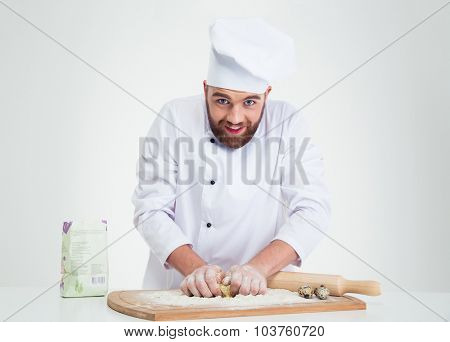 Portrait of a baker preparing dough for pastry isolated on a white background
