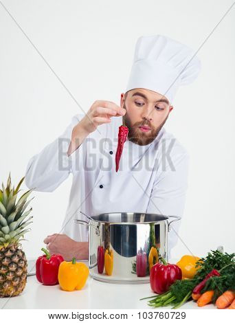 Portrait of a handsome chef cook preparing food isolated on a white background