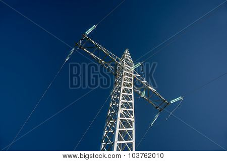 High-voltage Power Line Against Blue Sky