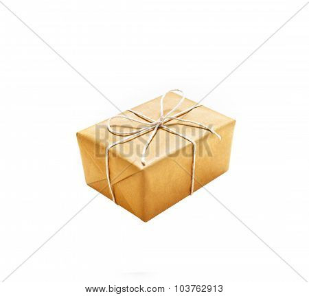 Carton giftbox with ribbon isolated on white