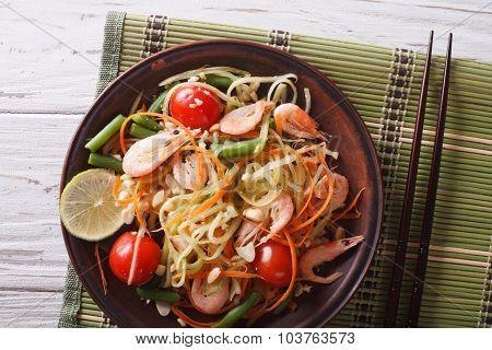 Thai Green Papaya Salad With Shrimp Close-up. Horizontal Top View