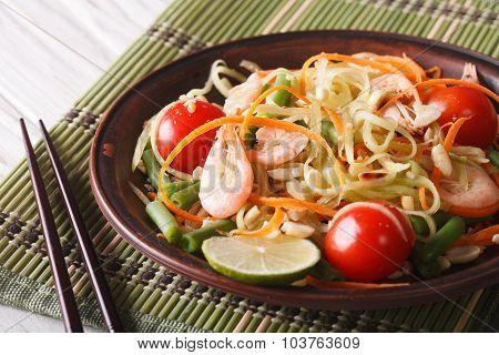 Thai Papaya Salad With Shrimp Close-up On A Plate. Horizontal