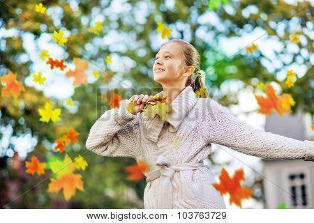Cute girl in autumn scenery