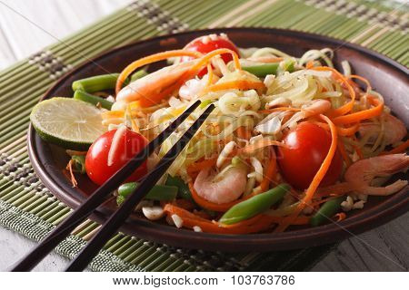Papaya Salad Som Tam With Shrimp Close-up On A Plate. Horizontal