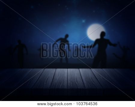 3D render of a wooden table looking out to a spooky Halloween zombie landscape