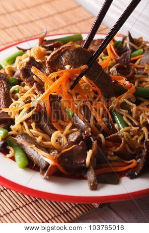 Lo Mein Noodles With Beef And Black Fungus Macro On A Plate. Vertical