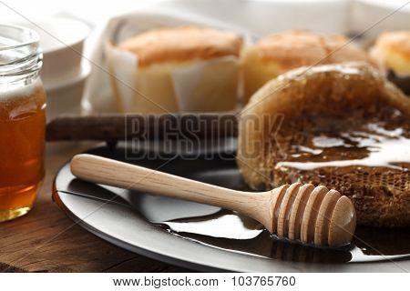 Wood Honey Dipper With Soft Cake Still Life Closeup