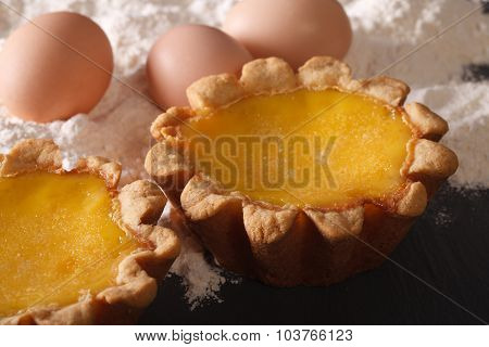 Traditional Egg Tart And Ingredients Close-up. Horizontal