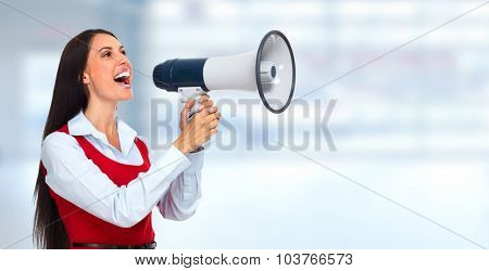 Young business woman with loudspeaker. Advertising concept.