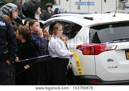 Hasidic children watch
