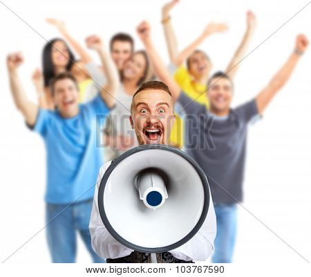 Young man talking in loud-hailer and group of happy people.