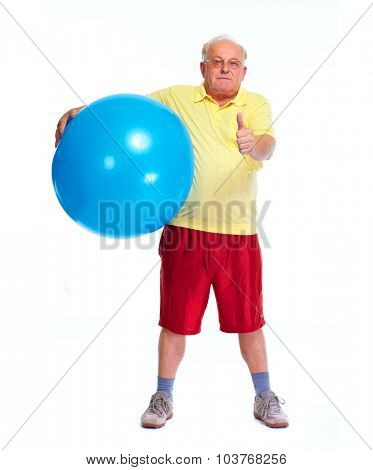 Elderly man with blue exercise ball. Sport and health.