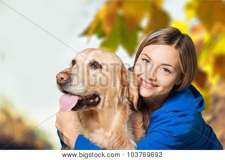 Hugging a dog.
