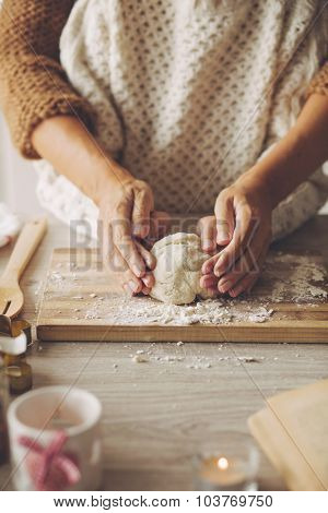 Mom with her daughter are cooking holiday pie in the kitchen, lifestyle photo series, hands closeup.