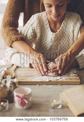 Mom with her 9 years old daughter are cooking holiday pie in the kitchen, lifestyle photo series, hands closeup.
