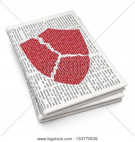 Security concept: Broken Shield on Newspaper background