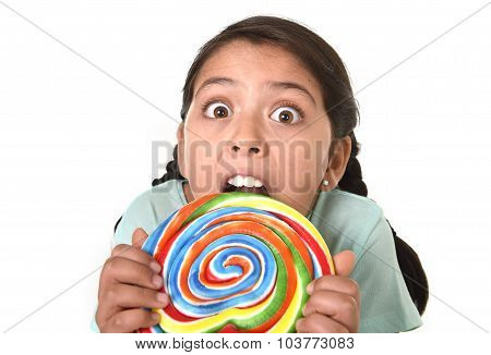 Happy Female Child Holding Big Lollipop Candy Biting The Candy With Her Teeth In Freak Crazy Funny F