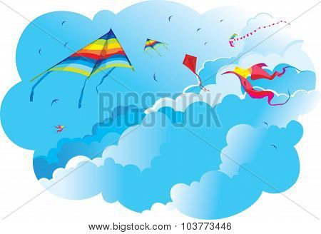 Kites and birds on the background of sky and clouds