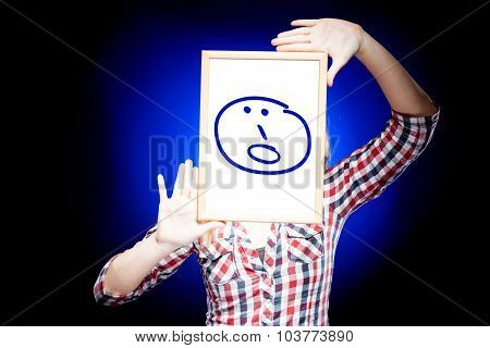 Woman Showing Surprised Emoticon In Front Of Face