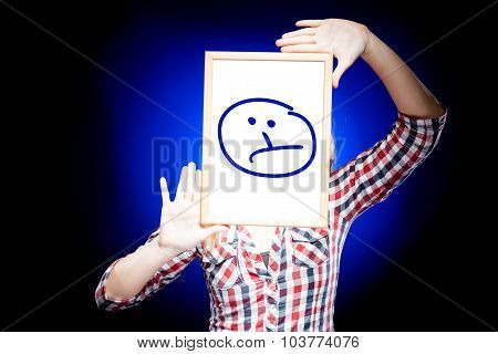 Woman Showing Sad Emoticon In Front Of Face