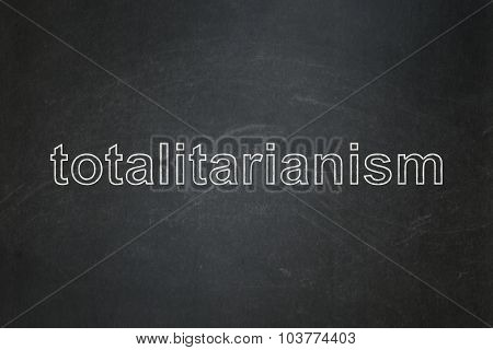 Political concept: Totalitarianism on chalkboard background