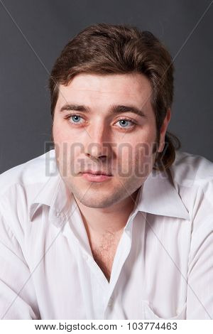 Man Posing In White Shirt