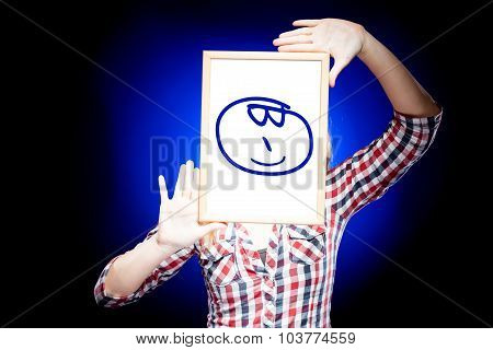 Woman Showing Glasses Emoticon In Front Of Face
