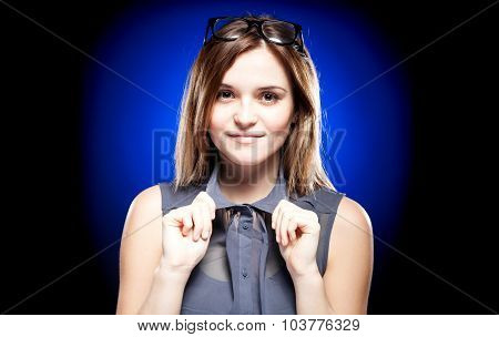 Young Woman With Nerd Glasses On Head Holding The Collar