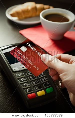 Man Using Payment Terminal With Nfc Technology In Cafeteria