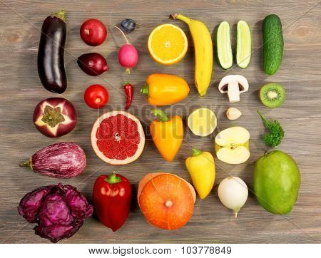 Different fruits and vegetables on wooden background