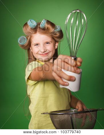 Little Girl Housewife Holding Kitchenware
