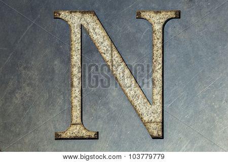 letter N cut in the metal sheet