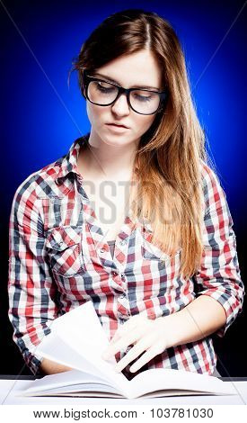 Calm Young Woman With Nerd Glasses Learning Diligently