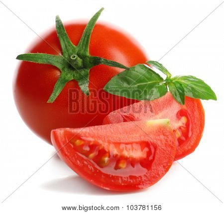 Whole and cut tomatoes isolated on white