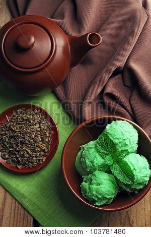 Homemade Green tea ice-cream on dark wooden background