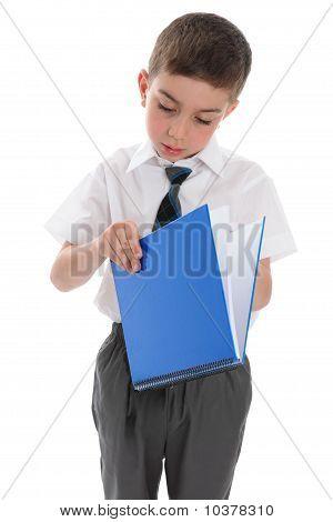 School Boy With Blue Book