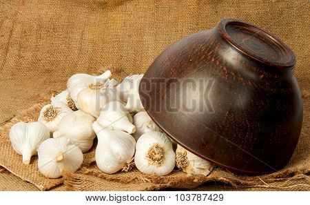Garlic Spill Out Of A Ceramic Bowl