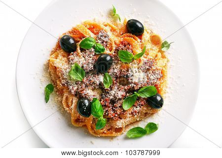 Pasta Bolognese with parmesan and basil on light background